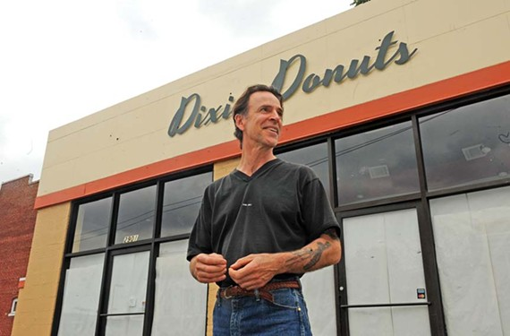 Chef J Frank waits for the other half of the Dixie Donuts sign, the round part, to arrive in Carytown. The business opens May 1 and will add Korean double-fried chicken to the menu next. - SCOTT ELMQUIST