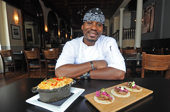 Chef Malcolm Mitchell prepares dishes such as tequila-braised short rib tacos and a six-cheese and Cheetos crumb mac and cheese at Mint Gastropub in the Fan. - SCOTT ELMQUIST