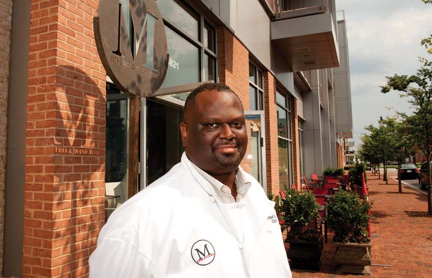 Chef Michael Hall expects M Bistro to open next week in Rocketts Landing, serving fine French comfort foods and wines in a contemporary setting. - SCOTT ELMQUIST