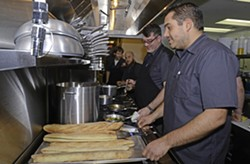 Chefs Lee Gregory and Joe Sparatta served up hors d'oeuvres at the preview of their new restaurant, Southbound, on Friday night. - SCOTT ELMQUIST