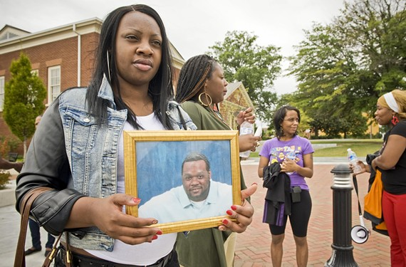 Chelsey Boyd holds a photo of her cousin, Pierre Cosby, who was shot to death during a robbery Nov. 26, 2011. He would have been 34 this year. His killer was sentenced last month to 40 years in prison. - ASH DANIEL