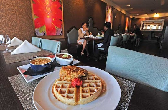 Chicken and waffles are served with sides of macaroni and cheese and beans at Mansion Five26, part of the Hippodrome entertainment complex in Jackson Ward. - SCOTT ELMQUIST