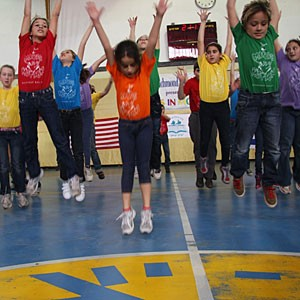 """Children at the Beit Yitzhak Regional School in Israel participate in Richmond Ballet's """"Minds in Motion"""" program. """"It's about transforming the kids,"""" the ballet's Brett Bonda says of the company's international outreach efforts."""