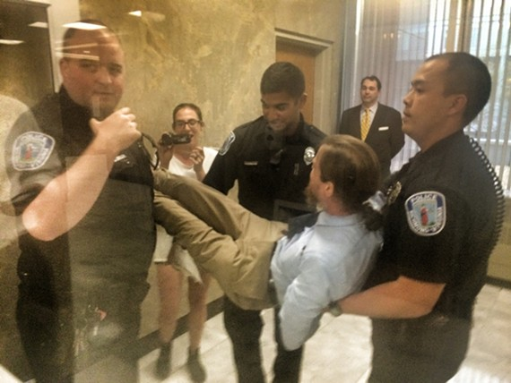Chris Dorsey, who ran for sheriff last year and is a regular voice during City Council's public comment periods, is carried out of Richmond City Hall in April.