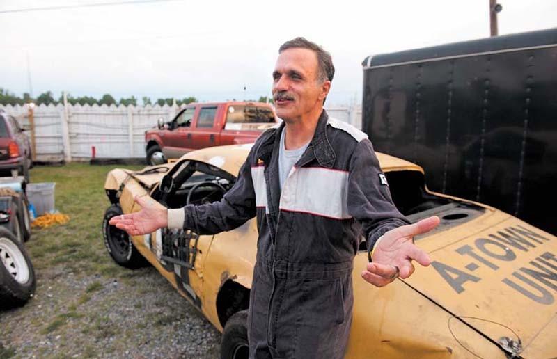 "Chris Kantzler with his ""half Camaro, half Firebird"" hybrid before the race on Friday night. - SCOTT ELMQUIST"