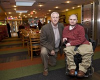 Co-owner of the Positive Vibe Café, Garth Larcen (pictured with his son, Max), started one of the first restaurants in the country to feature a training program for the disabled.