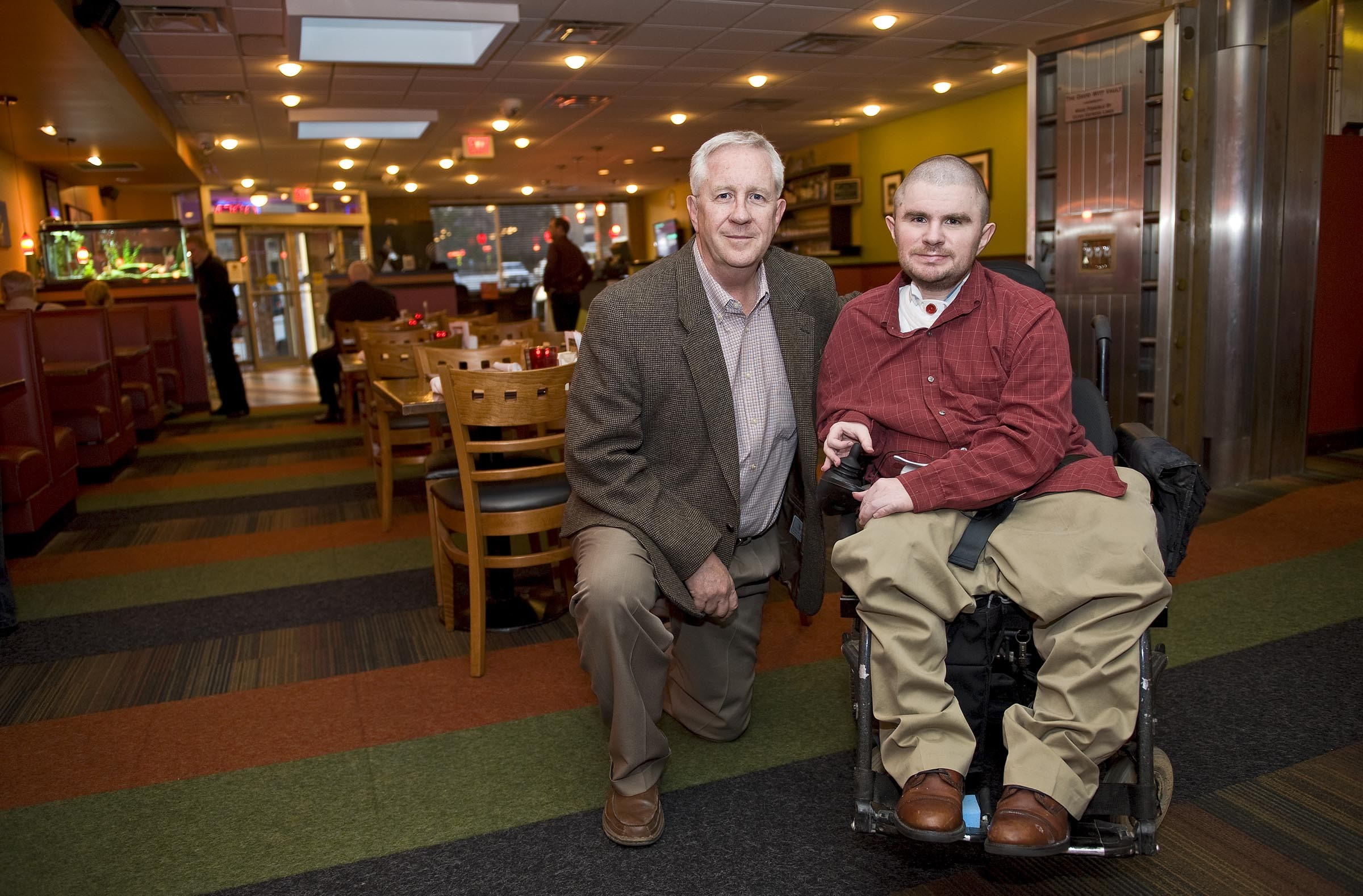 Co-owner of the Positive Vibe Café, Garth Larcen (pictured with his son, Max), started one of the first restaurants in the country to feature a training program for the disabled. - ASH DANIEL