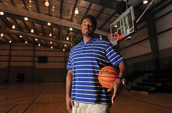 "Coach Derrick Johnson first met Garrick when he was 8. ""All Garrick wanted to do was play basketball,"" he recalls — ""all day, every day, that's all he wanted to do."" - SCOTT ELMQUIST"