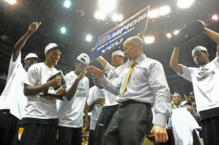 Coach Shaka Smart and the Rams celebrate after winning the CAA championship. - SCOTT ELMQUIST