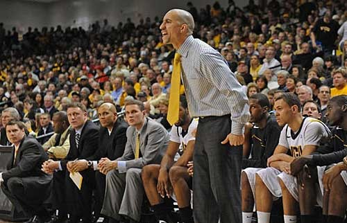 Coach Shaka Smart roams the sidelines during Virginia Commonwealth University's 22-point win over the University of Richmond on Dec. 9. - SCOTT ELMQUIST