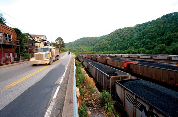 Coal rail cars and trucks ship Massey coal at Williamson, W.Va. - SCOTT ELMQUIST