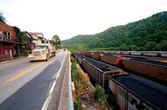Coal rail cars and trucks ship Massey coal at Williamson, W.Va. - SCOTT ELMQUIST