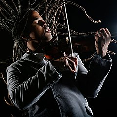 "Composer and violinist Daniel Bernard Roumain won a commission from the Sphinx Organization to write ""Dancers, Dreamers and Presidents,"" a musical suite inspired by Barack Obama's famous televised dance with Ellen DeGeneres.  ""It's reflective, open and accessible,"" Roumain says of the work, which will be performed by the Richmond Symphony this weekend. Photo by Julieta Cervantes."
