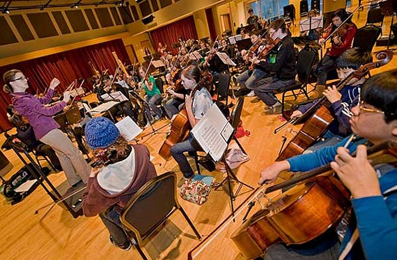 Conductor Erin Freeman leads the semiprofessional Richmond Youth Symphony Orchestra during a recent rehearsal. Celebrating 50 years of student outreach, all four of the symphony's various youth ensembles will perform during a special concert this week at CenterStage. - ASH DANIEL