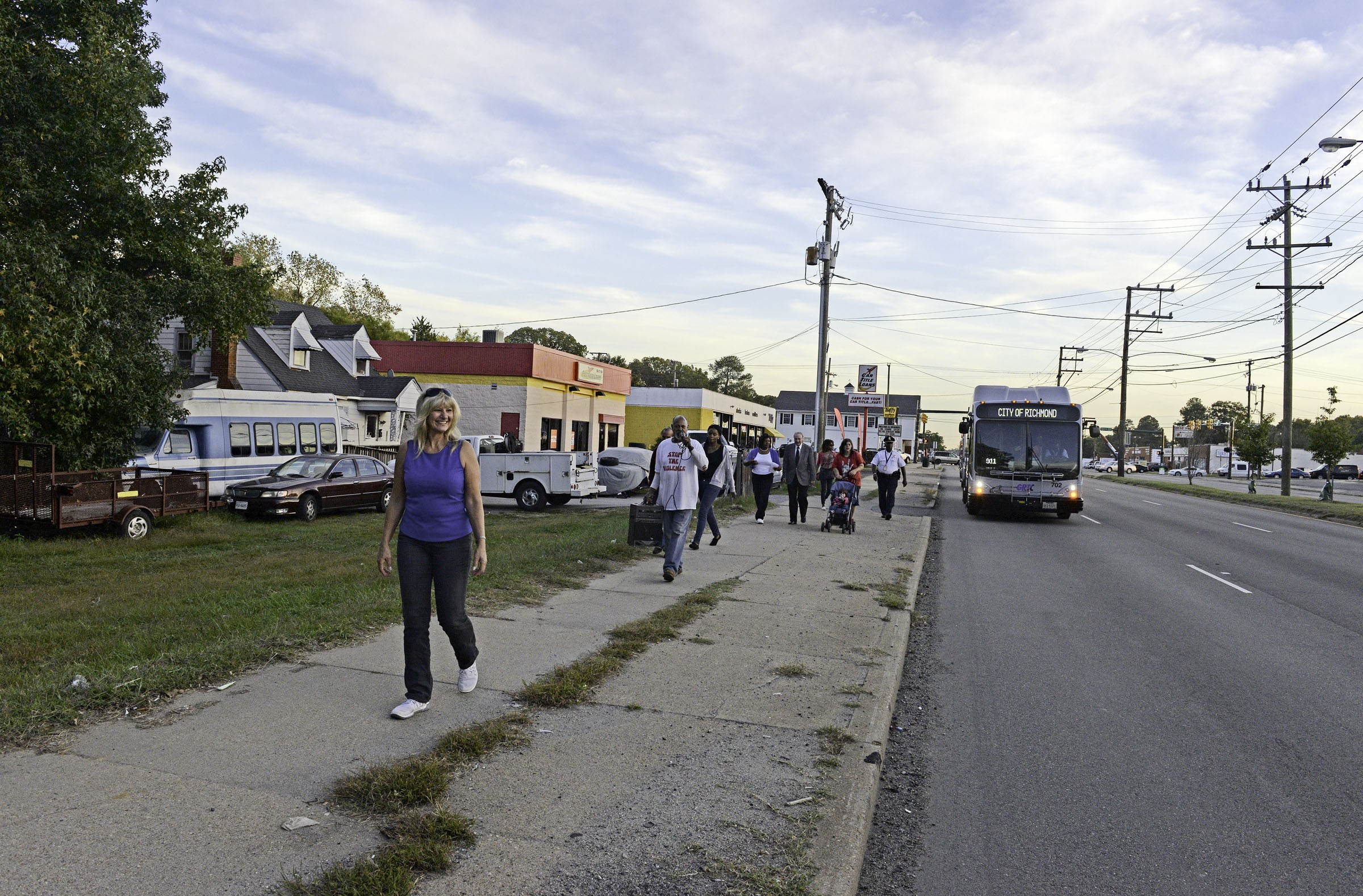 "Councilwoman Reva Trammell, who represents the city's 8th District, leads a ""march for a better neighborhood"" that she organized in October. About 60 residents walked the highway from Captain D's restaurant to Alexander Avenue. - SCOTT ELMQUIST"