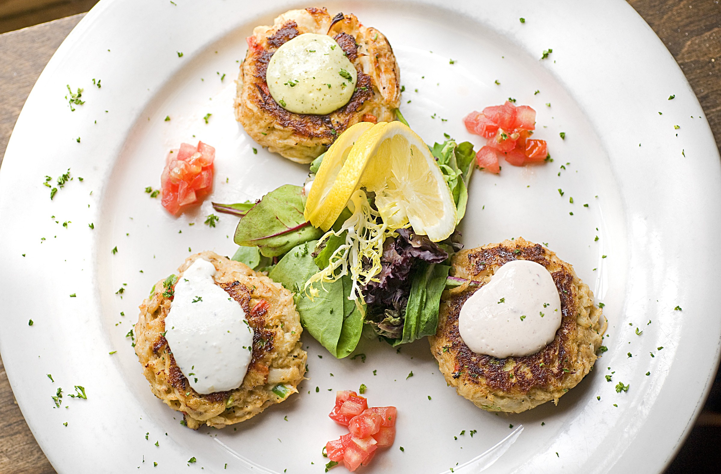 Crab cakes from Metro Grill. - ASH DANIEL
