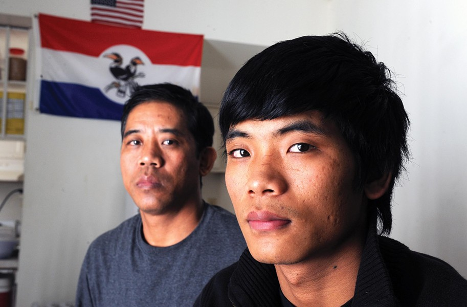 Cung Thawng and his son Samuel Lian fled from Burma, arriving in Richmond as refugees in 2009. Lian now is a freshman at Virginia Commonwealth University, and his father works in the kitchen at Richmond retirement community Westminster Canterbury. - SCOTT ELMQUIST