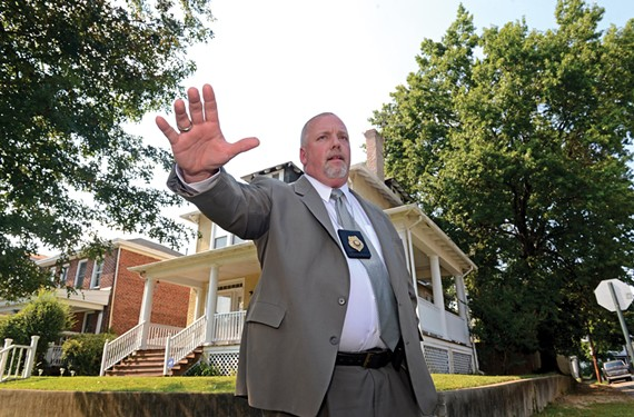 """Detective Bernard """"Mac"""" Adams stands at the corner near where a still-unknown shooter fired at two groups of young men walking down the street. One of the bullets struck Garrick near the middle of his throat. He died at VCU Medical Center. - SCOTT ELMQUIST"""