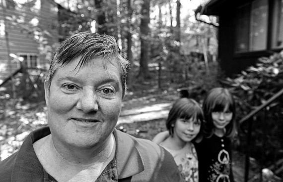 DeVoss with her granddaughters, twins Alyssa and Kali. - SCOTT ELMQUIST