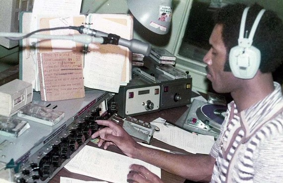 "Disc jockey Kirby Carmichael, shown here announcing for WANT 990-AM, once wrestled a bear for a radio promotion. ""That bear kicked my ass,"" he says. He's one of the jocks featured in a new documentary, ""The Soul R&B Radio Legends of Central Virginia."""
