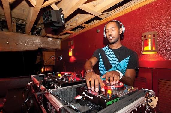 DJ Mass Fx spins downstairs at Europa. - SCOTT ELMQUIST