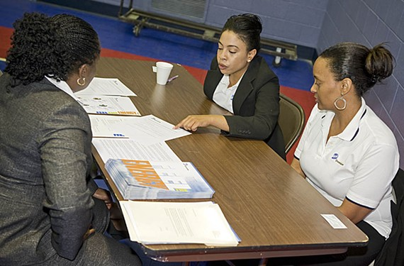 "Dominion Resources human resources specialists Crystal Johnson and Lenora Hughes meet with a new graduate of Griffin's job class. ""Be positive. Be persistent. Keep applying,"" Johnson tells discouraged job seekers."