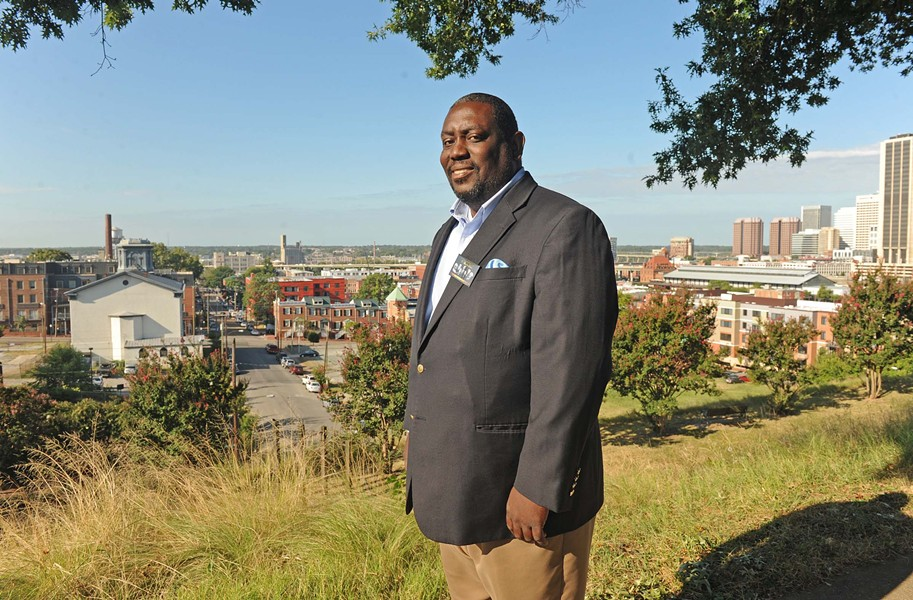 Don Coleman, the pastor of East End Fellowship and a member of the Richmond School Board, looks out at the city from Jefferson Park. He's among those trying to build community amid change in Church Hill. - SCOTT ELMQUIST