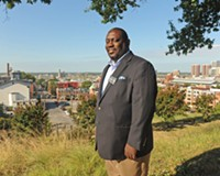 Don Coleman, the pastor of East End Fellowship and a member of the Richmond School Board, looks out at the city from Jefferson Park. He's among those trying to build community amid change in Church Hill.