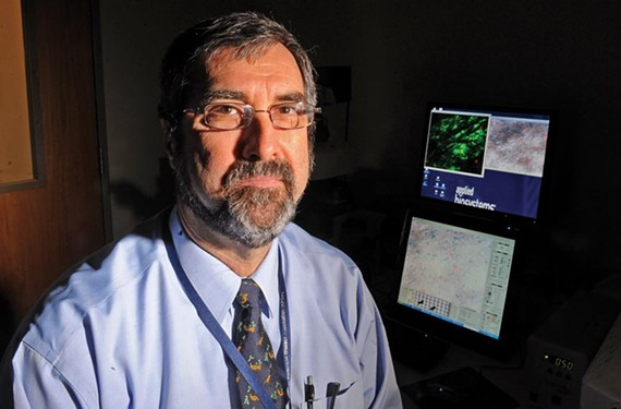 Dr. James P. Bennett Jr., director of the Parkinson's Disease and Movement Disorders Center, leads a team of researchers in seeking new therapies — and perhaps a cure — for the disorder. - SCOTT ELMQUIST