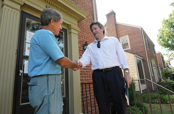 During his campaign in June 2012, then-City Council candidate Jon Baliles, right, chats with Charles Pond. - SCOTT ELMQUIST