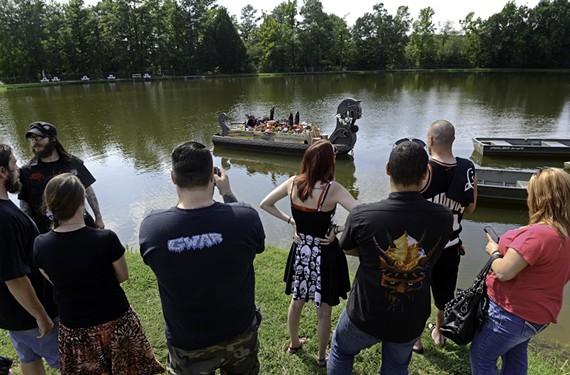 During the afternoon memorial, which kicked off the Gwar B-Q weekend, fans took photos, made toasts with Gwar Killsner beer and chanted Dave Brockie's name while his character's effigy floated in the lake. - SCOTT ELMQUIST