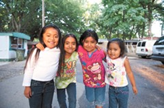 Early Sunday evening, friends play outside in the trailer park where they live with other Mixtecos off Jefferson Davis: Jackeline Leon, Marisol Mejia, Lorena Ariles and Jazmine Leon. - SCOTT ELMQUIST