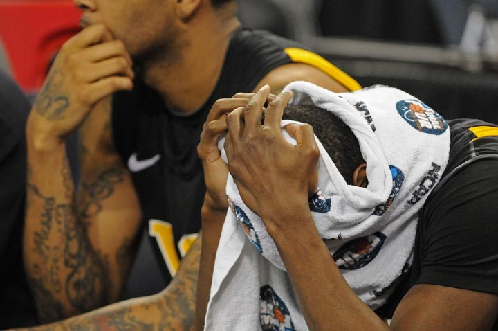 Ed Nixon hides his face while teammate Toby Veal watches the final moments of the game. - SCOTT ELMQUIST