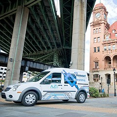 Electric car boosters and city officials joined Mayor Dwight Jones at an Oct. 28 news conference announcing the city's intention to purchase four electric vehicles, which will be different models than the Ford Transit Connect Electric shown here.