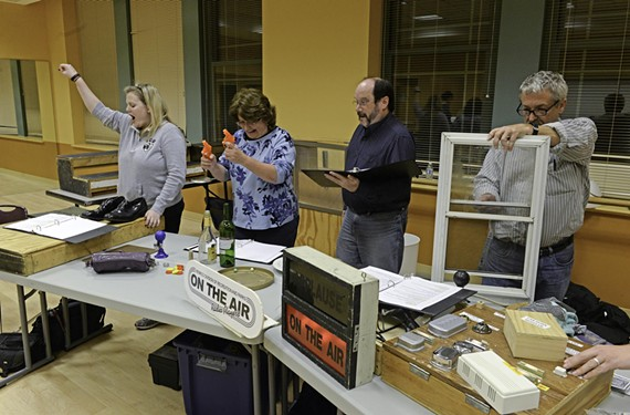 Emily Blair Powers, Ann Davis, Don Polaski and Tabb Justis create sound effects for the On the Air Radio Players, who are holding free performances at the Cultural Arts Center at Glen Allen.