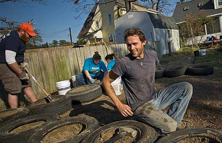 Eric Fulks is building his Westover Hills house from materials that would otherwise be thrown away. Old tires packed with earth act as a heat-absorbing thermal battery, he says. - ASH DANIEL