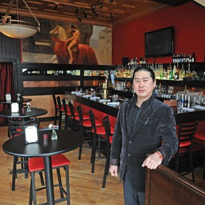 Fanhouse owner Sunny Zhao is asking the city to approve his first-floor bar, but the Fan District Association says his place has turned into a noisy nightspot.