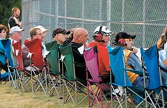 Fans and some crew chiefs watch the races from behind the fence at Southside Speedway on Aug. 19. - SCOTT ELMQUIST