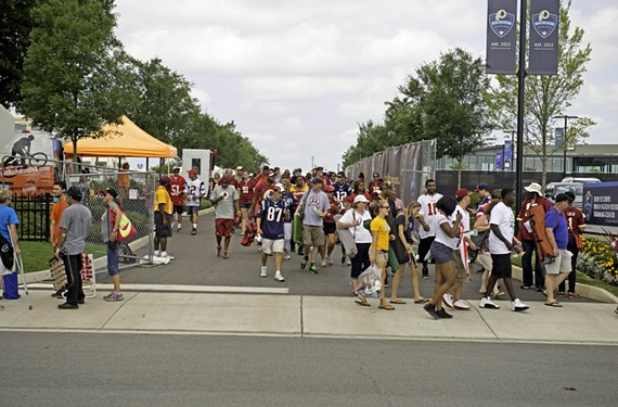 Fans exit Redskins training camp in Richmond during summer practice.