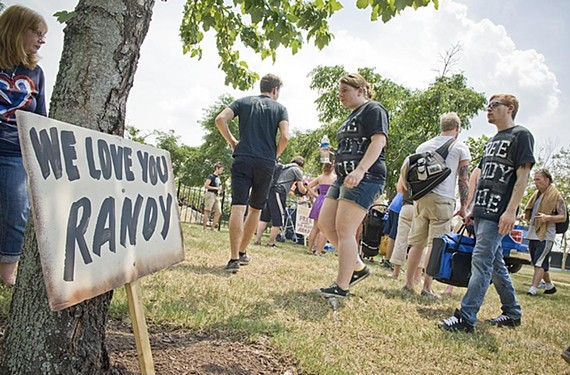 Fans gather to support Lamb of God singer Randy Blythe at a rally Sunday on Brown's Island. - ASH DANIEL