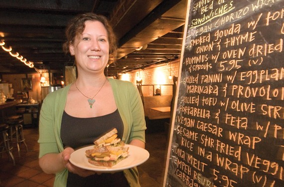 Feather, at Ipanema in 2009, holds an apple and Edam cheese sandwich. The menu was recently updated for the restaurant's 14th anniversary. - SCOTT ELMQUIST