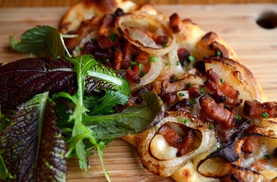 Flammkuchen, a pizzalike German dish, is topped with bacon, onion and crème fraîche.