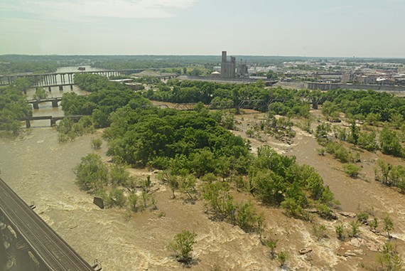 Flood waters rush over a chain of islands in the James River downtown. In the foreground is the island that is home to the great blue heron rookery. Just beyond it is Vauxhall Island, which goes up for auction Thursday. - SCOTT ELMQUIST