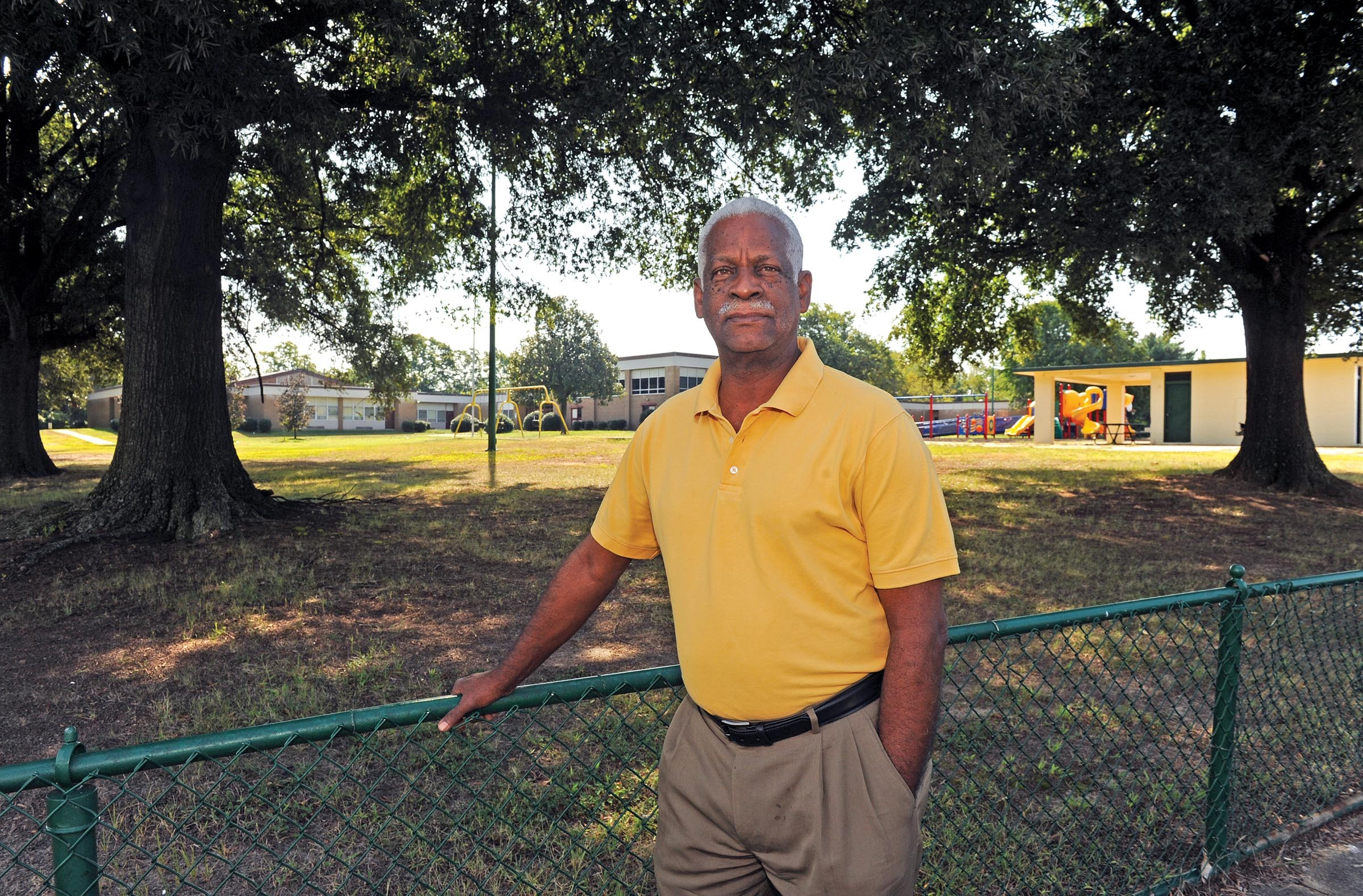 Former Richmond city councilman Marty Jewell, at the closed Clark Springs Elementary School, says the decision to redraw enrollment boundaries is a continuation of the school system's history of undermining integration. - SCOTT ELMQUIST