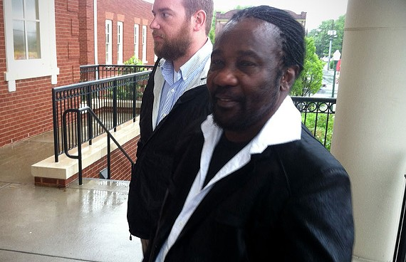 """Frederick """"Toots"""" Hibbert, front, with Stephen Lecky of Venture Richmond, stand outside Richmond General District Court in Manchester Friday. - NED OLIVER"""