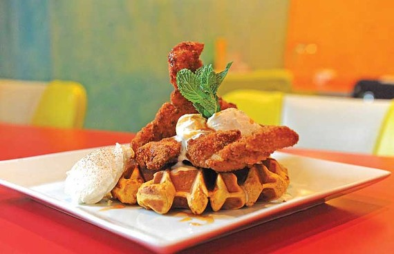 Fried chicken cutlets on a sweet potato waffle drizzled with chipotle syrup make brunch at Pescados China Street something out of the ordinary. - SCOTT ELMQUIST
