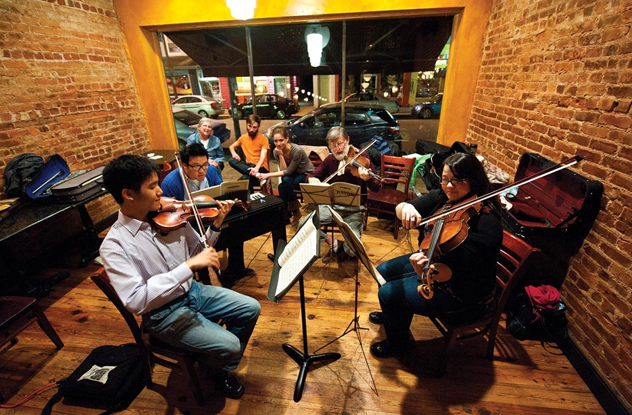 (From left) Frank Wu (violin), David Kim (piano), Hal Carle (violin) and Kimberly Ryan (viola) perform classical music at New York Deli. - SCOTT ELMQUIST
