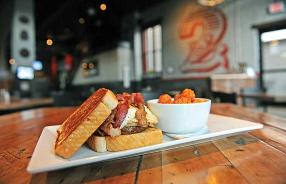 George Orwell gets his own burger at Station 2 in Shockoe Bottom. It stacks fried eggs, bacon, mozzarella and mayo on Texas toast. - SCOTT ELMQUIST