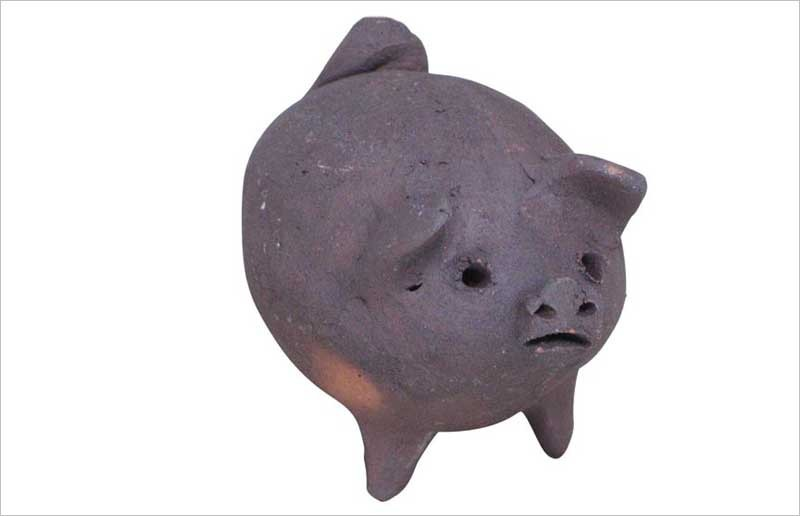 Good-luck clay pig from Ten Thousand Villages - TEN THOUSAND VILLAGES