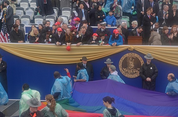 "Gov. Terry McAuliffe, center, waving to the crowd at his swearing-in, made his support for the LGBT community clear during his campaign. ""Not only were there people willing to support LGBT issues, they actually campaigned on them,"" Equality Virginia Executive Director James Parrish says. ""That shows people how far we've come."" - SCOTT ELMQUIST"